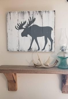 This moose is hand painted on rustic white boards. This sign would be a perfect gift or addition to your woodland theme decor! Perfect for a cabin! This sign measures about and comes ready to hang. Rustic Signs, Rustic Decor, Wood Signs, Decor Vintage, Rustic Wood, Moose Decor, Hunting Cabin Decor, Moose Crafts, Moose Pictures