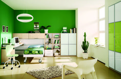 Green themed kids bedroom with roller bed and book shelves. #KBHome