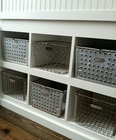vintage locker baskets for storage of small articles and shoes. Could be in a garage, bathroom or mud room.