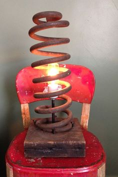 What better way to light up your home than with DIY decor? This old automotive coil was turned into a rustic lamp, attached to a chunk of reclaimed construction lumber. Learn more at LumberingBehemoth. Car Part Furniture, Automotive Furniture, Automotive Decor, Garage Furniture, Automotive Engineering, Engineering Jobs, Automotive Group, Bench Furniture, Handmade Furniture