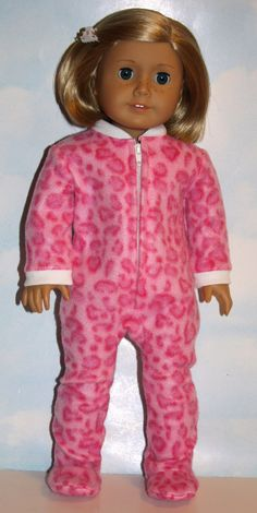 Snuggle up and stay warm this winter in cozy pink animal print fleece footed PJs. Zip front pajamas have white rib knit cuffs and neckband. All one piece - easy on/off!  Made by me in my smoke-free, pet-friendly home using a Matildas Closet pattern. All seams are serged/finished to prevent fraying.  Listing is for clothing described above only; my doll stays with me.  I am not affiliated with Mattel or American Girl. I am a Liberty Jane / Pixie Faire Partner.