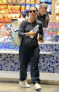 Bare-faced: Lily Allen, 31, looked lovely and natural as she arrived at LAX on Wednesday dressed-down and make-up free and wearing casual clothing