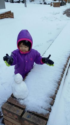 My baby's first snowman!!
