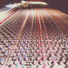 Excellent photography composition of the huge multi channel SSL music sound board at Record Plant Recording Studio. From cSw - http://www.pinterest.com/claxtonw/professional-recording-music-production/ -  SSLs are Solid State Logic Design and manufactured audio mixing consoles and digital post production systems for the music, video, film and broadcast industries.  Photo pin via GrammyNation