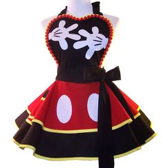 Retro Mickey Cosplay Apron, is a double, full circle, playful apron, full of flounce and ready to ship! Elements are handmade applique, sewn on the apron for long lasting wear.    All Aprons ship Via USPS Priority Mail $6.50    *Double layer full skirt.  *All edges are finished trimmed in bias. There are no raw edges.  *Sweetheart bib is lined with contrasting fabric and trimmed with ric rac.  *Extra long ties, to wrap and tie in front if you like  * Skirt measures 14 in length from…