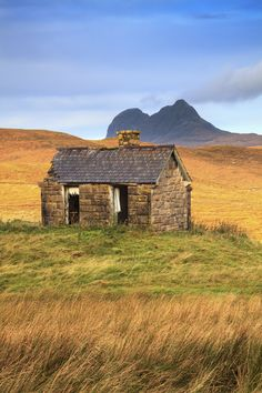 An abandoned building in the hamlet of Elphin in Sutherland, Scotland. Captured on a morning in October, with the prominent peak of Suilven in the distance.
