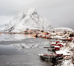 """upknorth: """" The northern lights are somewhere above those clouds. #getoutdoors #upknorth Snow-covered red fisherman's cabins in the Lofoten Islands, Norway. Awesome shot by @oldkyrenian"""