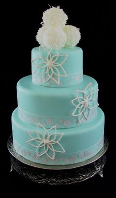 Wintery Snow Cakes. Very pretty blue wedding cake.