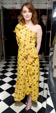 Emma Stone struck a maximalist chord at a pre-Golden Globes celebration, in which she wore a lemon-yellow ruffled one-shoulder Gucci gown with tiny fuchsia florals strewn all over, complete with metallic pink Gucci sandals.