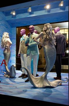 The man and the sirens (although the Sirens were actually half woman and half BIRD, mythologically speaking. Sorry, pet peeve!) - windows display Isaia Harrods London and boutique Milano