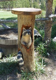 wood carving of a raccoon in a log, We all living beings are made of the same energy and substance either mater or antimatter, therefore we have to respect life in all its disguises, don't support animal killing for meat and pollution, go vegan and green for is a most, http://ninaohman4life.wordpress.com/