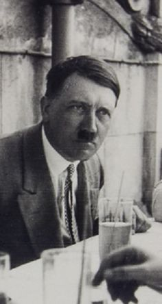 Handsome photo of Adolf Hitler, wearing a garish polka dot tie. This is June, 1930. This is perhaps the only photo of Hitler shown drinking a beer. Before the Putsch, he would sometimes drink 4 liters of Optimator in an evening after a speech. By the late 20's, he was restricting himself to one liter of his favorite beer, Weihenstephan Hefe Weißbier. It looks like a straw in these glasses, but Weißbier is sometimes served with lemon or a radish, thus the stick to stir it. (via putschgirl)