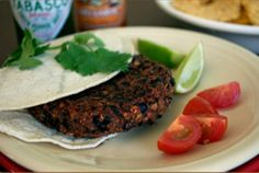 quick black bean Burgers   ■15-oz can black beans, drained and rinsed  ■2 tbsp ketchup  ■1 tbsp yellow mustard 1 tsp onion powder (granulated)  ■1 tsp garlic powder (granulated)  ■1/3 cup instant oats  combine, form 4 burgers, bake on parchment paper - 7 min. on each side in 400 degree oven
