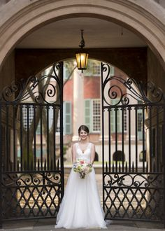 Bridal Portraits taken by Ava Moore Photography on the Cistern at the College of Charleston. Featuring Florals by Wild Flowers, Inc and the Allure Romance 2716 with an all lace back.
