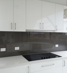 Metallic charcoal colours look stunning against white kitchens