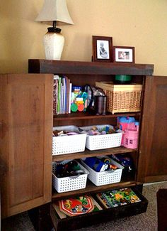 repurpose media armoire or kitchen cupboard for toy storage!