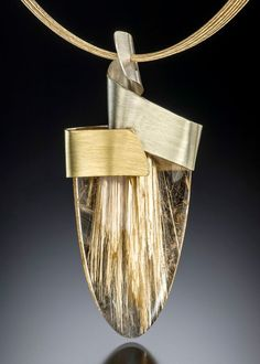 Golden Radiance. Sunshine pendant features a magnificent rutilated quartz set within a ribbon of gradient Spectra gold. adamneeley.com