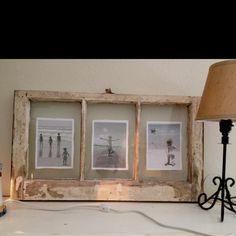 Window pane frame turned into a photo frame..