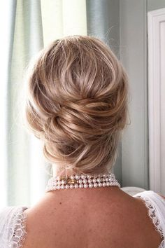 Messy chignon wedding hairstyle inspiration #hair #hairstylist#hairstyle #updo #bridalupdo #hairupdo#messybun #frenchchignon #chignon#bridal #bridalhair #lowupdo