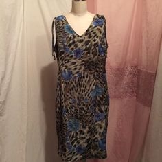 R&K green sleeveless sun animal print floral dress Size 8 petite Green animal print sleeveless dress with blue flowers. Approximate measurement 34 inches hips 41 inches length from shoulder seem to bottom 37 inches R & K Dresses