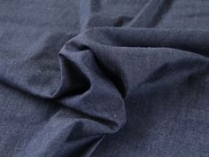This dress fabric is a versatile light weight blue denim (4oz) with a soft touch(washed).   This denim fabric is great for shirts, shirt dresses and skirts.   This dress making fabric is 100% cotton and is 145cm wide.