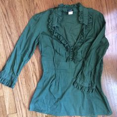 J. Crew Kelly green cotton ruffle top EUC this J. Crew 100% cotton ruffle blouse is in perfect condition. beautiful ruffle details on sleeves, chest, and neck. the fit is very flattering with a cinched waist and flows bottom. perfect piece for heading into spring! J. Crew Tops Blouses