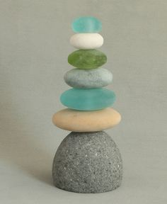 Colorful Cairn garden sculpture of natural rock and glass for the outdoors. 12 inches high.
