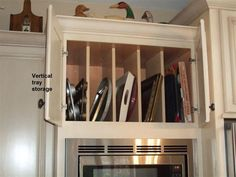 ... Sheets, And Cookbooks Using Plywood Shelves To Create Vertical Storage  In A Cabinet! [Vintage White Maple Cabinets Purchased    Www.cabinetgiant. Com] ...