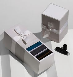 """Designed by Container   Country: China/Australia  """"Container has helped Elle Macpherson Intimates add value to their customer experience. A drawer box for gifting multiple knickers used a sliding tray inner and was shipped fully made up (with a bow on top) while a 'pulse point' oil became a sweet smelling GWP provided as a turnkey solution."""""""