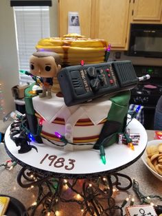 Stranger things birthday cake. Fondant walkie talkie and eggos for eleven. Dungeons and dragons wizard with christmas lights