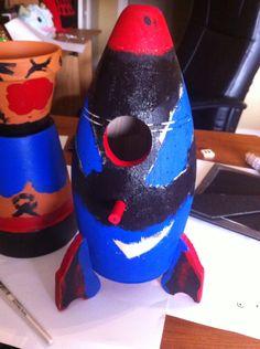 Tribal rocket birdhouse using acrylic paint.