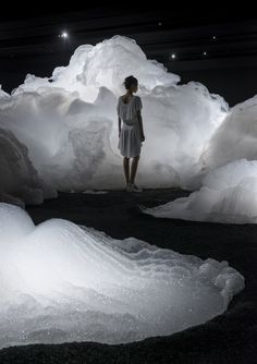 Japanese artist Kohei Nawa has created an installation that immerses viewers into its billowy white forms. // Titled Foam, the installation was created using a mixture of detergent, glycerin, and water. After experimenting with ingredient ratios, the artist developed a mixture where forms could hold their shape, and the installation could maintain its cloud-like poofs. With nearly black walls and select lighting, the ethereal forms subtly sway in the quiet air.