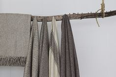 save the biggest of the old  nails  from the floor joist. Throw blankets on a branch display at Atelier St. George, Janaki Larsen's new Vancouver showroom   Remodelista