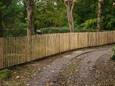 Solid, stout,  chestnut paling fencing- 3 wire version. Made by us in #Haslemere.