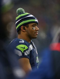 Quarterback Russell Wilson #3 of the Seattle Seahawks looks on from the sidelines during the second half of the game against the Arizona Cardinals