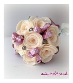 A pretty flower wand of six handmade cream felt roses with sparkly detailing. £35.00