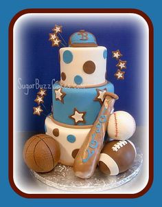 Sports theme baby shower cake...maybe red and white or black and white stripes instead of the polka dots