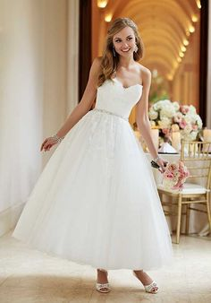Can I add little cap sleeves? A blast from the past, this '50s-inspired wedding gown from Stella York features a fitted lace bodice, figure-flattering Diamante waist belt, and a whimsical tulle ankle-length skirt. Dressed in spectacular lace and enchanting tulle, this Stella York dress is sure to highlight your personality and make you the center of attention.