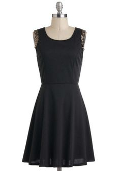 Simple, chic dress. Love the sparkly shoulders