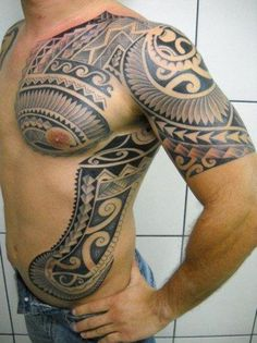 tribal-tattoo-on-chest-shoulder-and-rib - 70+ Awesome Tribal Tattoo Designs | Art and Design