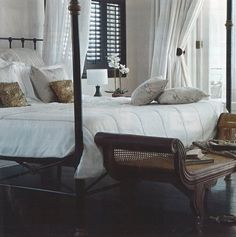Drapes and shutter combo in this luxurious island style boudior.