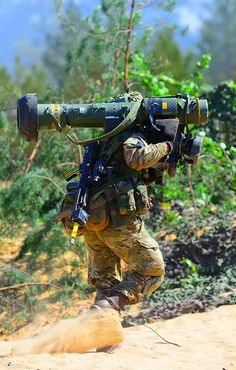 Javelin Rocket Launcher | RGR soldier carries a Javelin missile launcher during…