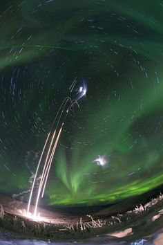 A Night at Poker Flat • Image Credit: NASA / Jamie Adkins • Four NASA suborbital sounding rockets leapt into the night on January 26, from the University of Alaska's Poker Flat Research Range. This time lapse composite image follows all four launches of the small, multi-stage rockets to explore winter's mesmerizing, aurora-filled skies. During the exposures, stars trailed around the North Celestial Pole, high above the horizon at the site 30 miles north of Fairbanks, Alaska...