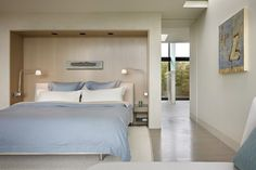 Clean, modern bedroom in light blue and white. From Robin Chell Designs, discovered on search.porch.com