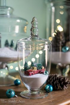 christmas apothecary jars - create your own snow scene inside a glass vase for beautiful and creative christmas decoration.