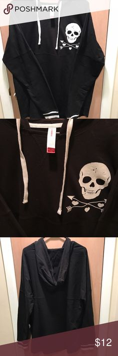 Women's oversized Skull Hoodie! NWOT (XXL) NWOT women's No Boundaries brand black hoodie with skull on chest and white stripes on wrists of sleeves. Size XXL in Juniors for the perfect oversized hoodie. No front pocket. No Boundaries Tops Sweatshirts & Hoodies