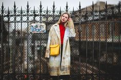 Primary colors get toned down with a more muted, painterly stroked topcoat. It's color-blocking, in a way you wouldn't expect. #refinery29 http://www.refinery29.com/2016/03/105661/paris-fashion-week-fall-winter-2016-street-style-pictures#slide-4
