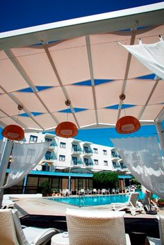 Relaxing by the pool ; Hotel Suites, Cyprus, Relax, Hotel Bedrooms