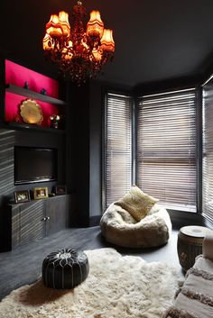 Dark glam room, with pops of colour.