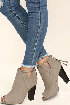"You deserve to treat yourself to a cute new outfit and the For Me Taupe Suede Peep-Toe Booties! Ultra soft vegan suede is formed to a cute peep-toe upper, and ankle-high shaft with cutout collar, and rounded strap accent. 3"" heel zipper with pull."
